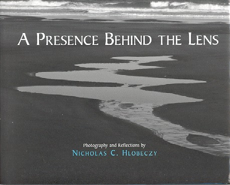 A PRESENCE BEHIND THE LENS.; Photography and Reflections. Nicholas C. Hlobeczy.